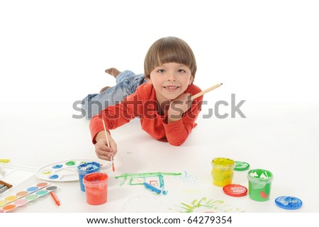 little happy boy draws paint. Isolated on white background - stock photo