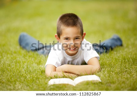 little happy boy reading book - stock photo