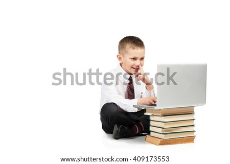 Little Happy Funny Boy sitting with laptop computer and school books. Technology education. White background isolated - stock photo