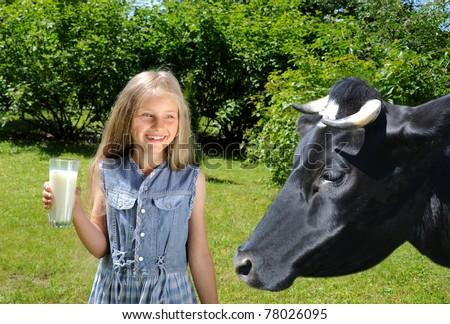 Little happy girl drinking milk - stock photo