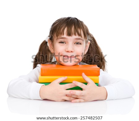 little happy girl embracing books. isolated on white background - stock photo