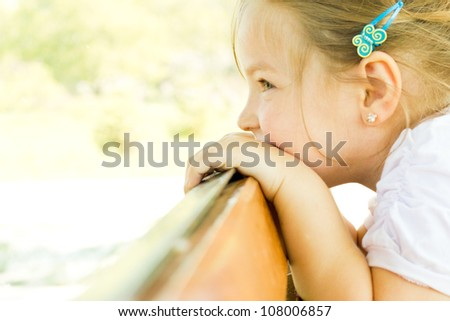 Little happy girl having fun in a summer park - stock photo