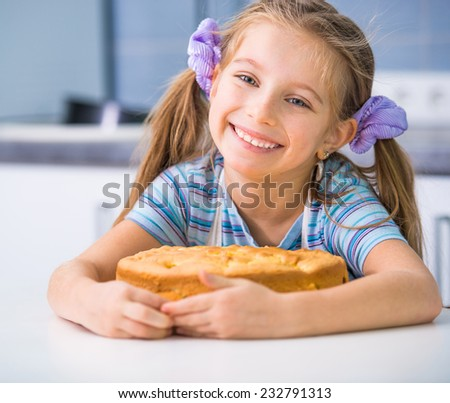 little happy girl showing apple pie that she baked - stock photo