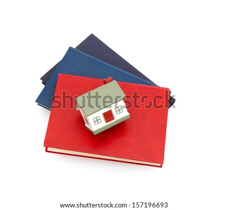 little house and books isolated on white background - stock photo