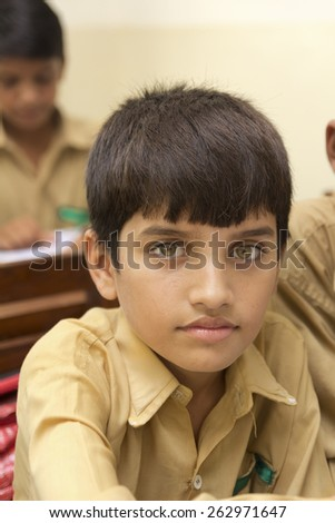 Little Indian boy in class - stock photo