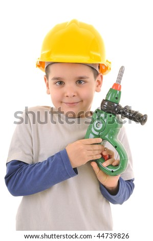Little kid as a construction worker wearing yellow helmet with a toy drill in his hand..White background studio picture. - stock photo