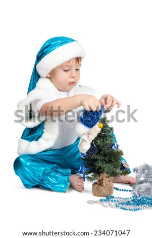 Little kid boy in blue New Year costumes decorated Christmas tree isolated on a white background - stock photo