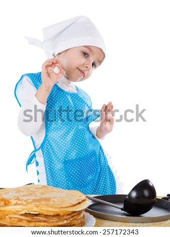 Little kid cooking pancakes. One cute girl playing as chef. Surprise for Mothers Day. Isolated on a white background. - stock photo