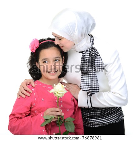 little kid girl is giving her mother a beautiful flower - stock photo