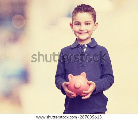 little kid holding a piggy bank - stock photo