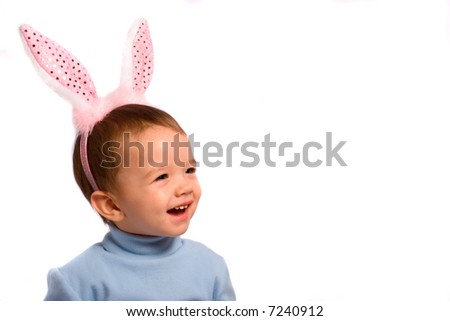 Little kid in rose rabbit's horn - stock photo