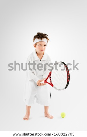 Little Kid playing Tennis Champion  - stock photo