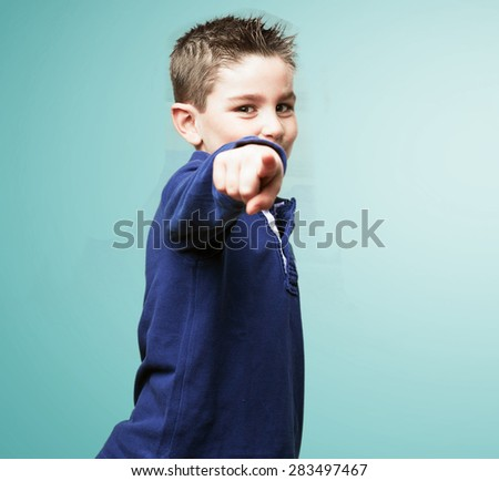 little kid pointing to front - stock photo