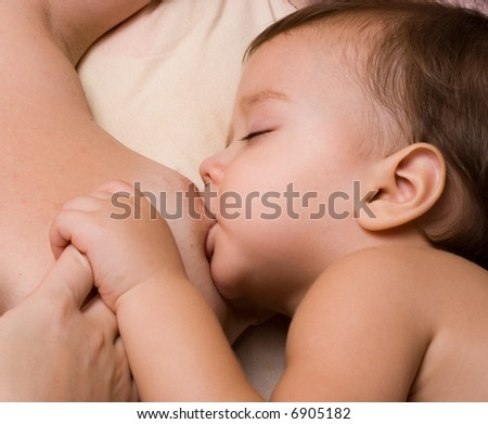 Little kid sleeping and breast-feed - stock photo