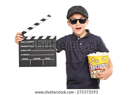 Little kid with a beret and sunglasses holding a box of popcorn and a movie clapperboard isolated on white background - stock photo