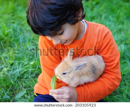 Little kid with bunny - stock photo