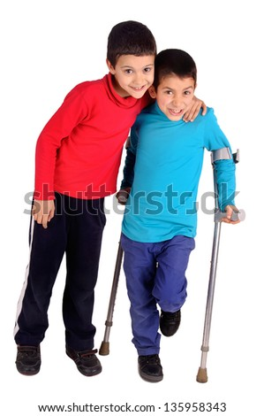 little kid with crutches - stock photo