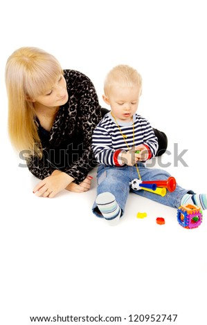 little kid with my mom plays with toys isolated on white background - stock photo