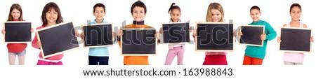 little kids holding blackboards isolated in white - stock photo