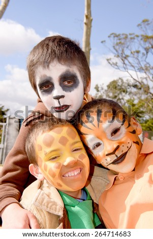 little kids with face painted - stock photo