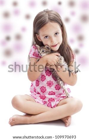little kitten in a smile girl hand - stock photo