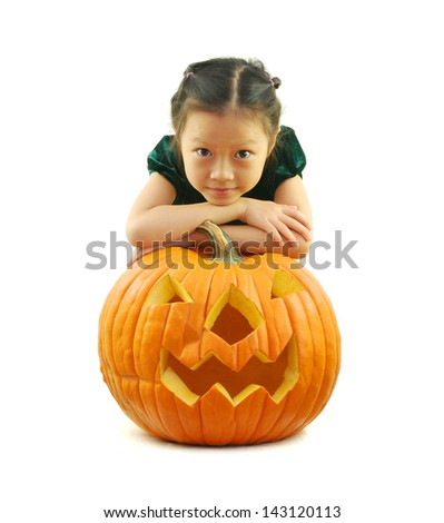 Little laughing girl with halloween pumpkin on white - stock photo