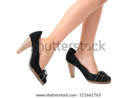 little legs in mommy's shoes, isolated on white - stock photo