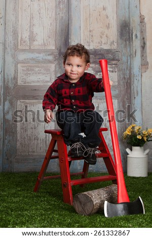 Little Lumberjack.  Adorable toddler dressed as a lumberjack. - stock photo