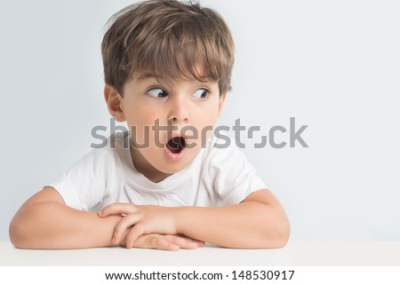 Little man is suprised and so happy about it. Closeup headshot. - stock photo