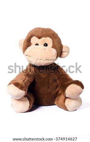 Little monkey plush soft toy isolated on white - stock photo