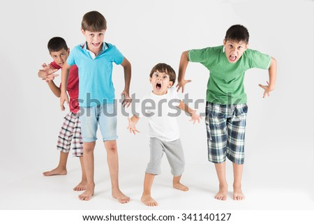 Little monster zombies with agony and mad expression  - stock photo
