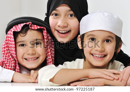 Little Muslim Arabic girl and two boys portrait - stock photo