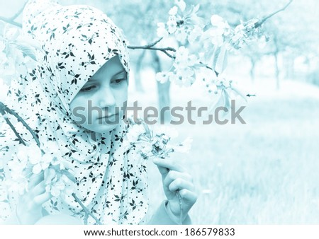 Little muslim girl outdoor - Spring time - stock photo
