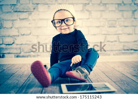Little nerd with digital tablet - stock photo