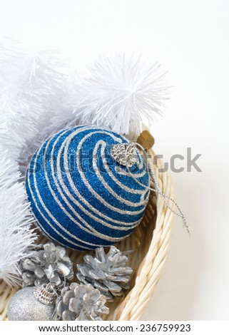 Little New year tree toys in the box on the wood backing - stock photo