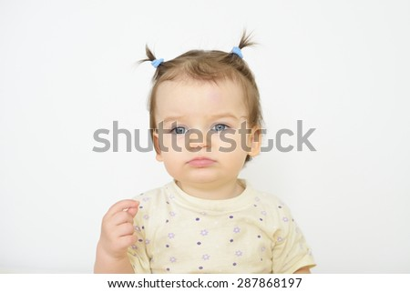 Little newborn baby girl. Parenting or love concept. Sad tired child. - stock photo