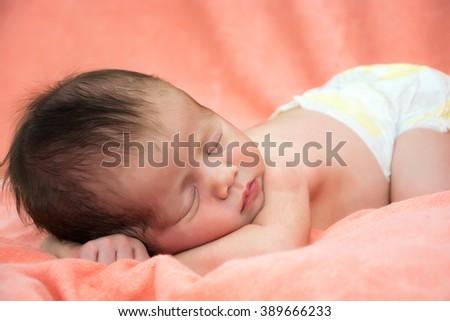 Little newborn baby girl sleeps - stock photo