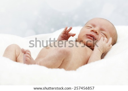 Little newborn lying on the blanket - stock photo
