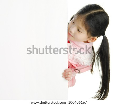 Little pan asian girl looking at white blank card - stock photo