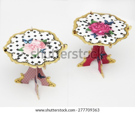 little paper table with ornaments as decoration for parties - stock photo