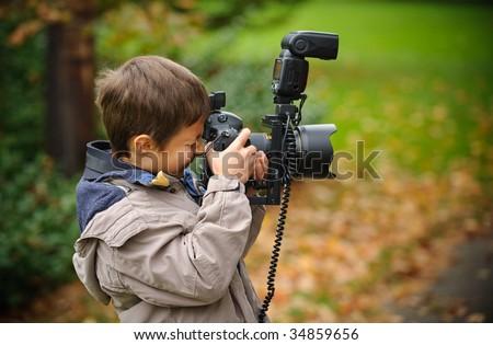 Little photographer - stock photo