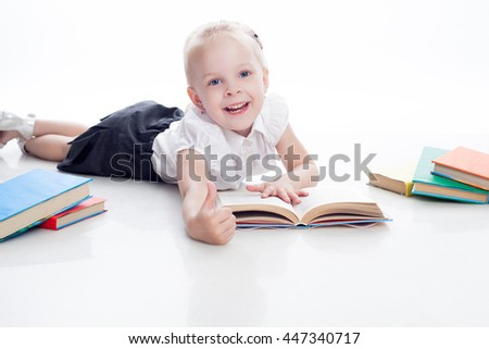 Little preschool girl read book and show finger up, isolated on white background - stock photo
