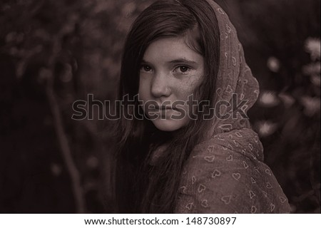 little preteen girl with red scarf and dark long hair black and white dramatic portrait - stock photo