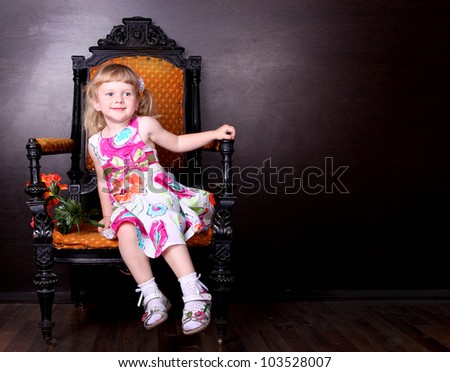 little pretty girl sitting on the chair - stock photo