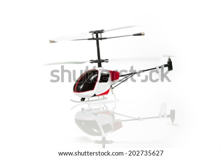 Little RC helicopter on white background - stock photo