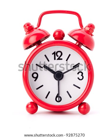 Little red alarm clock on a white background - stock photo