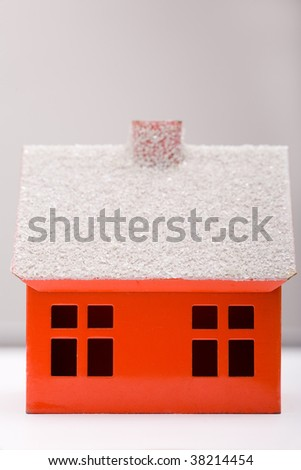 Little red house with chimney and windows - stock photo