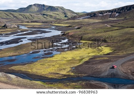 little red off road car adventuring in Iceland - stock photo