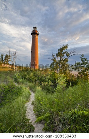 Little Sable Point Lighthouse. Image of the Little Sable Point Lighthouse at sunset. - stock photo