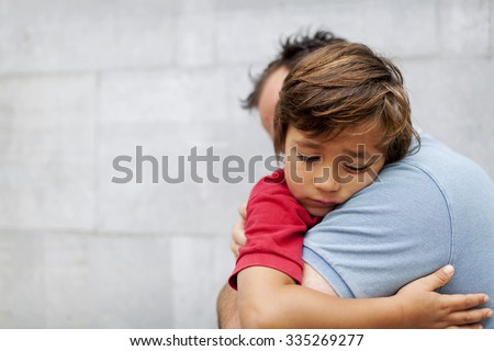 Little sad boy whith his dad - stock photo